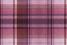 Tartan Red pattern - Plaid Clothing Table. Plaid is a pattern consisting of crossed horizontal and vertical bands in two or more colours in woven cloth Royalty Free Stock Photo