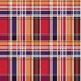 Tartan seamless texture mainly in red and blue hues Royalty Free Stock Image
