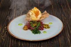 Tartar beef with mustard. And rucola Stock Photos
