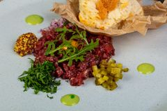 Tartar beef with mustard. And rucola Royalty Free Stock Images