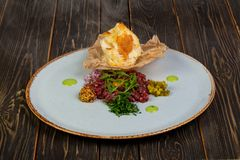 Tartar beef with mustard. And rucola Royalty Free Stock Photography