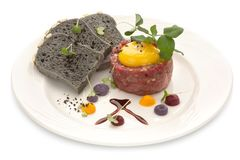Tartar with black bread and yolk, isolate. Tartar with black bread and yolk. Molecular modern cuisine. Chips Pigskin with tartare or carpaccio of beef. Stock Royalty Free Stock Image