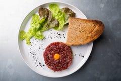 Tartar dish on a white plate Stock Photo