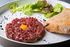Tartar dish on a white plate Royalty Free Stock Photography