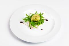 Tartar from salmon with creamy pine-nuts, kiwi and lemon sorbet. Stock Photos