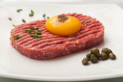 Tartar steak with egg and capers Stock Photos