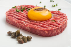 Tartar steak with egg and capers Royalty Free Stock Photo