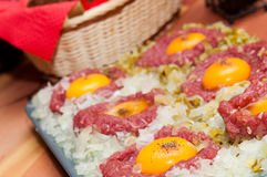 Tartar steak with egg onion and pickle Royalty Free Stock Photos