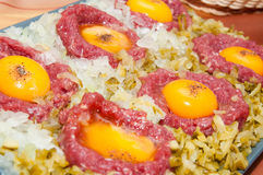 Tartar steak with egg onion and pickle Royalty Free Stock Images