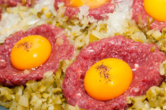 Tartar steak with egg onion and pickle Stock Image