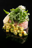 Tartar from tuna fish with avocado, flying fish roe and rucola Stock Photo