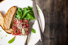 Tartare of beef with spinach. Royalty Free Stock Images