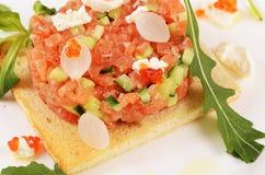 The tartare of salmon on bun Royalty Free Stock Photo