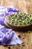 Tarte de pistache de fraisier commun Images stock