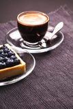 Tarte et café de myrtille Photographie stock