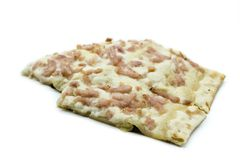 Tarte flambee with onions and ham isolated on white background stock image