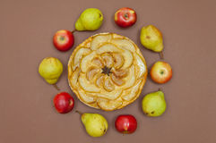 Tarte Tatin apple pear tart with fruits on brown background Stock Photography