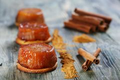 Tarte Tatin with apples and cinnamon. Royalty Free Stock Images
