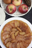 Tarte tatin with apples high angle view. Upside down tarte tatin with caramelized apples and fruits in background, high angle view Stock Images