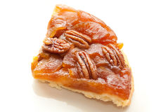 Tarte Tatin with pecan nuts. Piece of Tarte Tatin, type of apple tart with caramellized nuts and apples Stock Photography