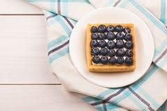 Tartelette avec les bluebarries et la crème anglaise Photos stock