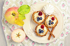 Tartelette with cream and berries on white plate Stock Photo