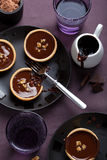 Tartelettes with chocolate ganache and nuts Stock Images