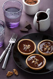 Tartelettes with chocolate ganache and walnut Royalty Free Stock Images