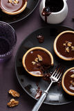 Tartelettes with chocolate ganache and walnuts Royalty Free Stock Images