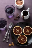 Tartelettes with chocolate ganache and walnuts Stock Photos