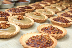 Tartelettes with nuts. Filling on sale at Provinçal market in France Stock Photography