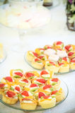 Tartes with strawberry. Candy arrangement, that can be used for decorating tables at the wedding Royalty Free Stock Images