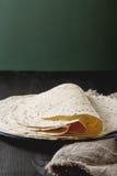 Tartilla sheets on a gray background. Brown cloth. Mexican food. Stock Photos