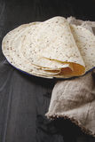 Tartilla sheets on a gray background. Brown cloth. Mexican food. Royalty Free Stock Image