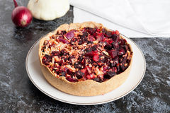 Tartlet with beetroot, red onion and goat cheese | Beet Pie Stock Images