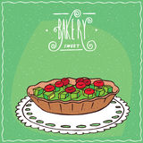 Tartlet with berries and kiwi on lacy napkin Royalty Free Stock Photo