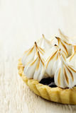 Tartlet with berry confiture and meringue Royalty Free Stock Image