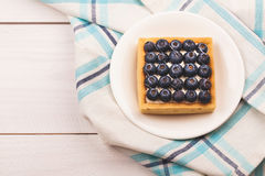 Tartlet with bluebarries and custard Stock Photos