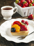Tartlet with chantilly cream and berries Stock Photos
