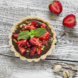 Tartlet with chocolate cream, strawberries and pistachios Royalty Free Stock Photo
