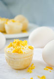 Tartlet with cottage cheese, garlic and eggs on blue background Royalty Free Stock Photos