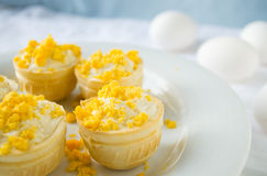 Tartlet with cottage cheese, garlic and eggs on blue background Stock Images