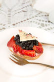 Tartlet with custard, berries and white chocolate Royalty Free Stock Photography