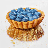 Tartlet with fresh blueberries Stock Image