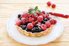 Tartlet with fresh raspberries and currants. Food closeup Royalty Free Stock Images