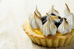 Tartlet with lemon curd, blueberries and meringue Royalty Free Stock Images
