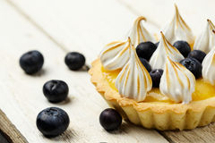 Tartlet with lemon curd, blueberries and meringue Stock Photos