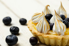 Tartlet with lemon curd, blueberries and meringue Stock Image