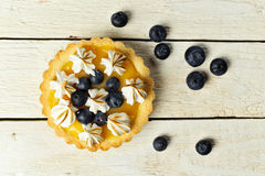 Tartlet with lemon curd, blueberries and meringue Royalty Free Stock Photography