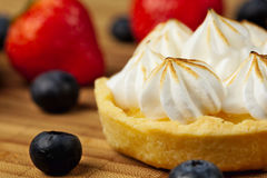 Tartlet with lemon curd and meringue Stock Photography